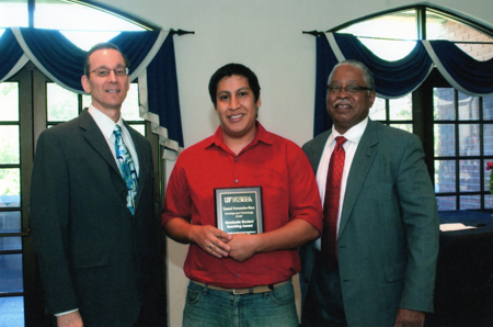 Dan Fernandez-Baca receives his Graduate Student Teaching Award from Dr. Joe Glover (left) and Dr. Henry Frierson (right)