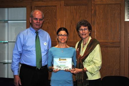 Dr. Kristin Joos accepts the 2013 UF Champions for Change Sustainable Solutions in Academics Award (aka Sustainability Professor of the Year) from President Bernie & Chris Machen.