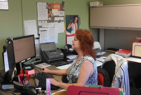 Sheryl McIntosh at work making the department run smoothly.