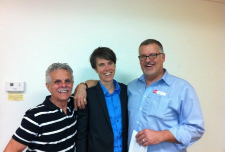 Dr. Kendal Broad about to give a talk about her research at Parents, Families and Friends of Lesbians and Gays in Gainesville (with PFLAG Gainesville Board Member Larry Ligammare and Vice-President William Dougherty.)